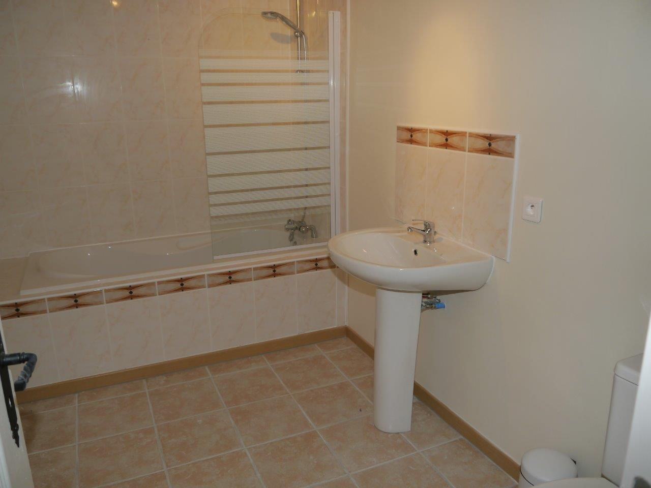 Bathroom downstairs with bath and sink(1)